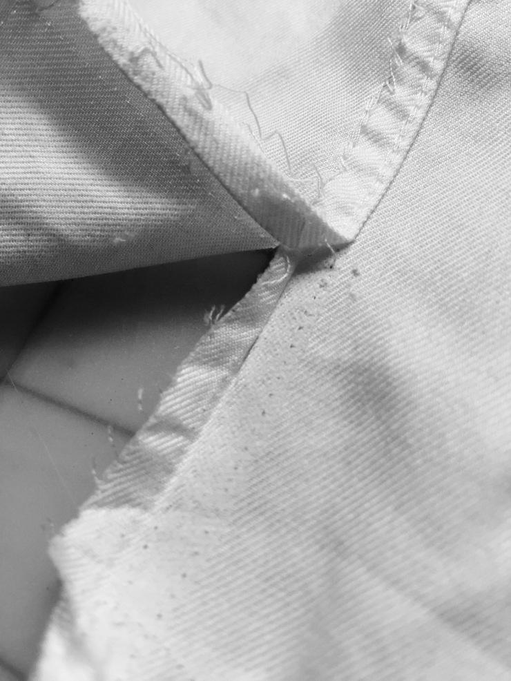 glue on the bottom - shirt back seamline